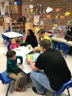 High School Students Read to Preschool Class